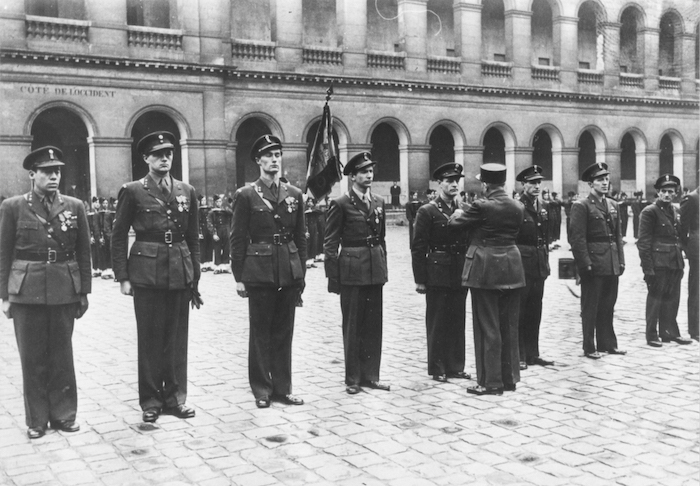 From left to right, Haukelid, Paulsson, Rønneberg, Kayser,Kjelstrup, Haugland, Strømsheim, and Storhaug receive official honors for their service.