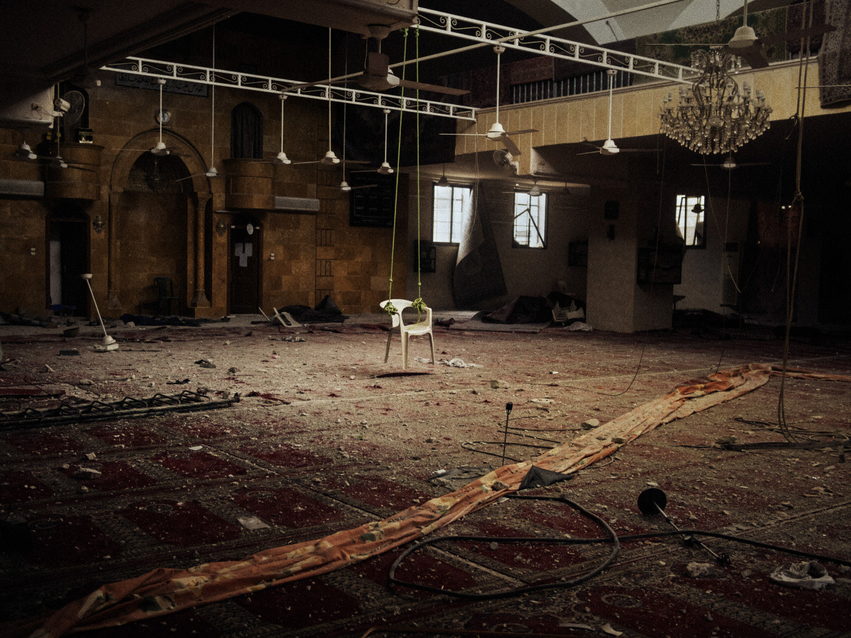 Aleppo, Syria. March, 2013. A makeshift swing made with a plastic chair found inside a mosque that was occupied by Syrian Army soldiers on the Salahaddin front line in Aleppo.