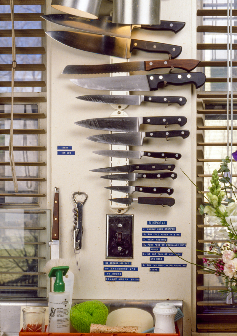 Detail of magnetic knife storage by window.