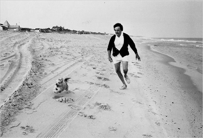 Kurt Vonnegut with dog on beach